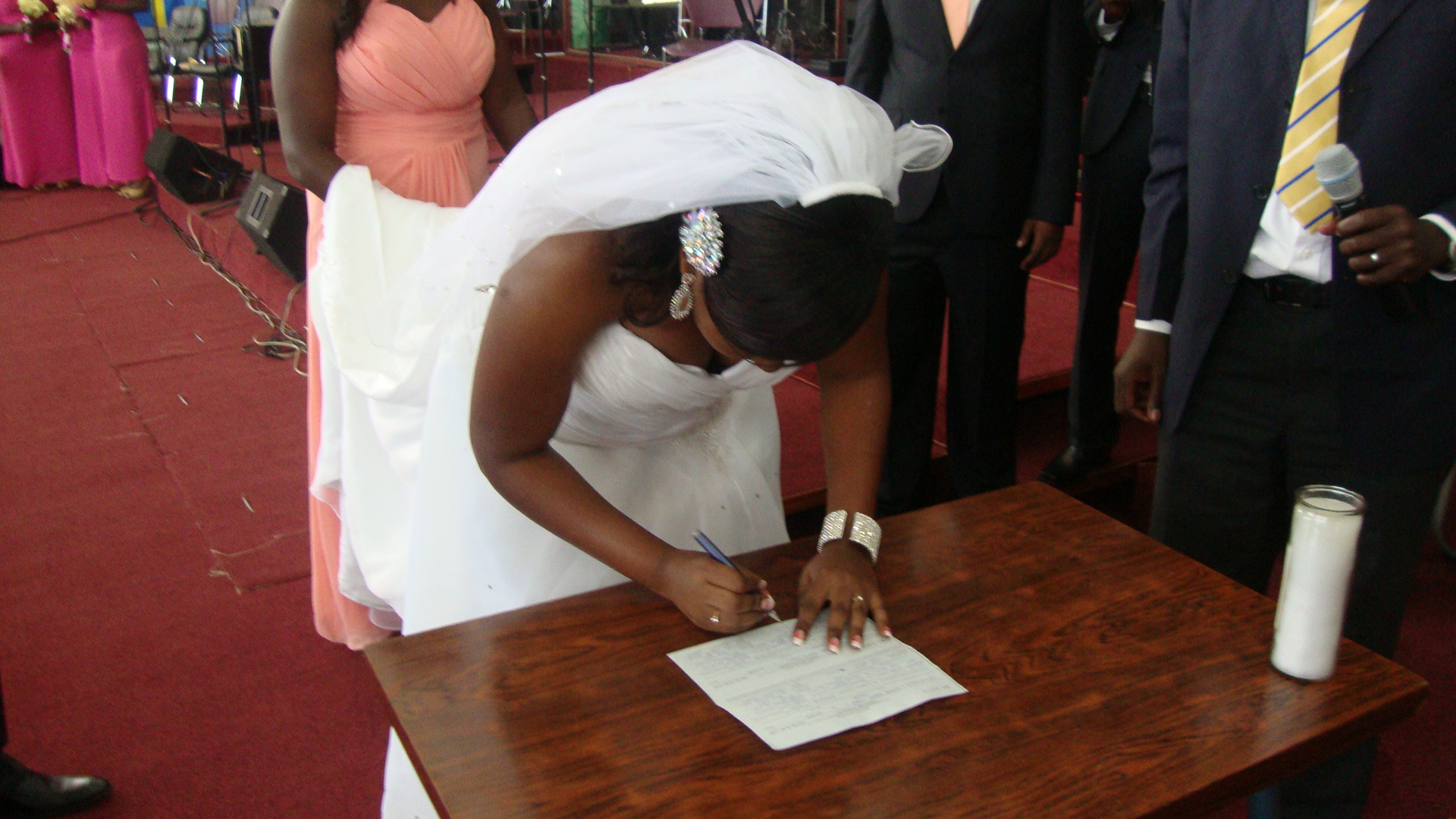 Bride signing her marriage certificate