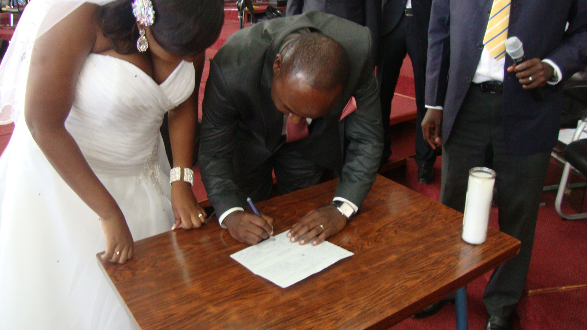 The groom signing the marriage certificate as well.